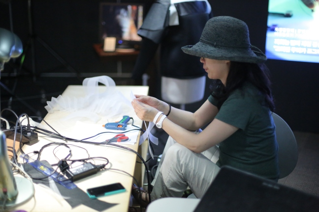 Younghui working on the inner textile.